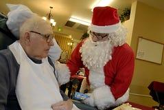santa y jubilado Fotos de archivo libres de regalías