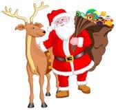 Santa y reno con el regalo Foto de archivo libre de regalías