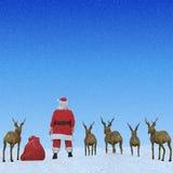 Santa y sus nubes de los renos Fotografía de archivo libre de regalías