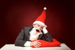 Santa yawning Royalty Free Stock Image
