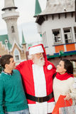 Santa with a young couple Stock Photos