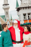 Santa with a young couple Royalty Free Stock Images