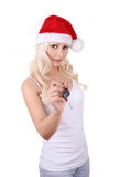 Santa young girl in Christmas hat gives car key. Isolated on white royalty free stock images
