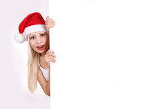 Santa young girl holding white board. With space for text on white background Stock Image