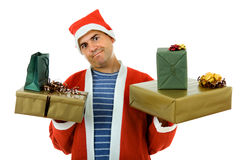 Santa. Young man with santa hat holding some gifts, isolated Stock Photo