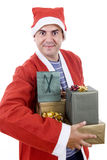 Santa. Young man with santa hat holding some gifts, isolated Royalty Free Stock Photography
