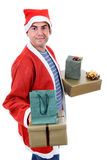 Santa. Young man with santa hat holding some gifts, isolated Royalty Free Stock Image