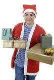 Santa. Young man with santa hat holding some gifts, isolated Royalty Free Stock Photo