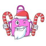 Santa z cukierku kuchennym fartuchem umieszczającym nad kreskówka stół royalty ilustracja