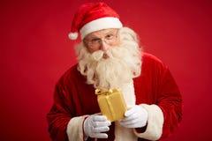 Santa z pakunkiem obraz royalty free