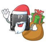 Santa z prezenta guzikiem f7 odizolowywającym w charakterze ilustracja wektor