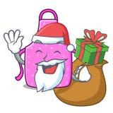 Santa z prezenta kuchennym fartuchem umieszczającym nad kreskówka stół ilustracji