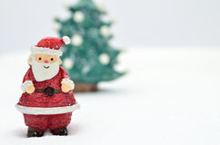 Santaclaus and tree on snow Royalty Free Stock Images