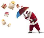 Santaclaus vs gifts Stock Photos