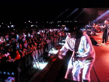 Santana Concert on Dubai Jazz Festival. Carlos Santana playing guitar in front of his fans Royalty Free Stock Images