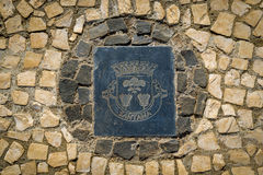 Santana district emblem on the stone pavement. Madeira island Royalty Free Stock Photography