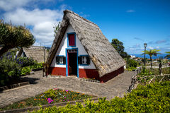 Santana in Madeira is a beautiful village on the north coast. is known by its small thatched triangular houses. Stock Photo