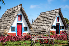 Santana in Madeira is a beautiful village on the north coast. is known by its small thatched triangular houses. Stock Photos