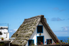 Santana in Madeira is a beautiful village on the north coast. is known by its small thatched triangular houses. Royalty Free Stock Image