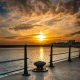 Santander Bay at sunset behind the fence Stock Image