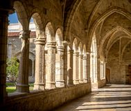 Santander Cathedral, hallway, columns and arches of the cloister. Santander Cathedral, detail of a hallway, columns and arches of the cloister Stock Photos