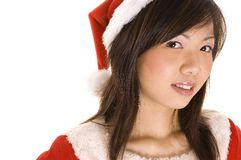 Santarina 9. A young chinese woman in a santa hat and costume royalty free stock images