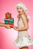 Santarina con i regali Immagini Stock