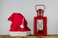 Santas покрывают и фонарик Стоковые Изображения