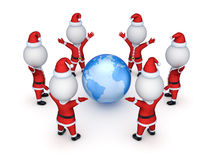 Santas around Earth. Royalty Free Stock Images