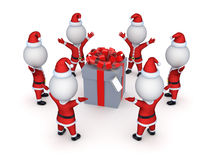 Santas around giftbox. Royalty Free Stock Photo