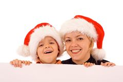 Santas behind white banner Royalty Free Stock Photography