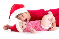 Santas. Christmas baby - siblings wearing as Santa Stock Photos