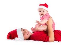 Santas. Christmas baby - siblings wearing as Santa Royalty Free Stock Image