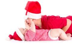 Santas. Christmas baby - siblings wearing as Santa on white Royalty Free Stock Photos
