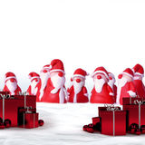 Santas and christmas gifts Royalty Free Stock Images