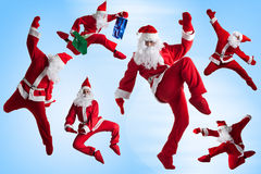 Santas Clause. Santa Clause dancer blue background stock photos