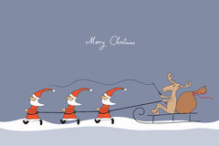 The Santas come with the reindeer in a sleigh and sack. Santa comes, santaclaus, christmas sleigh and reindeer, sleigh ride, reindeer in sleigh, santa sleigh Royalty Free Stock Photography
