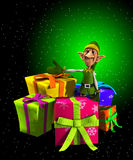 Santas Elf With Presents. Santas Elf with a lot of Christmas presents for Christmas Royalty Free Stock Photo