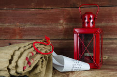 Santas equipment - burlap bag, wish list and lantern Stock Photography