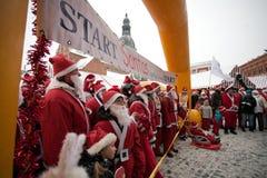 Santas Fun Run & Walk in Riga, Latvia. RIGA, LATVIA - DECEMBER 12: Participants of the third annual Santas Fun Run & Walk in Riga, Latvia, 12 December, 2010 Royalty Free Stock Image
