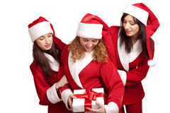 Santas with a gift box Royalty Free Stock Images