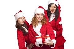 Santas with a gift box Royalty Free Stock Photo