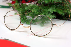 Santas Glasses. Christmas ornaments, glasses and card on white background Royalty Free Stock Image