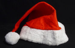 Santas hat. On a black background royalty free stock image
