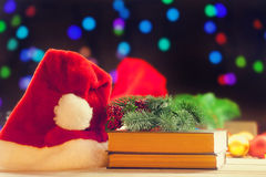 Santas hat and books Stock Photography