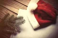 Santas hat and branch Royalty Free Stock Photos