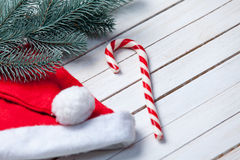 Santas hat and christmas candy Stock Photography