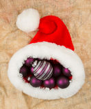 Santas hat filled with Christmas balls Royalty Free Stock Photography