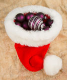 Santas hat filled with Christmas balls Royalty Free Stock Photos