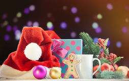 Santas hat and gingerbread with cup Royalty Free Stock Photography